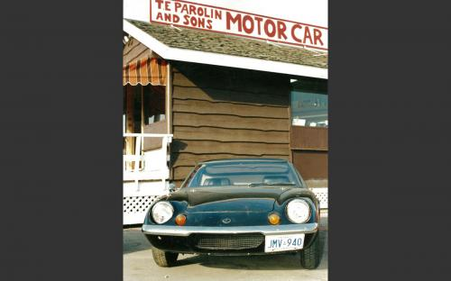 "1969 Lotus Europa S2 in front of the ""sales shack"" at 1405 Hammond. The ""sales shack"" served as Terry's main office at the lot until he added the service shop to the business in 1990."