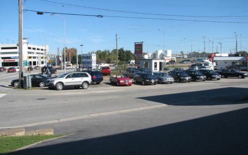 "One of the final photos taken of the Hammond Street lot sometime in 2006.  A stalwart of the North Bay automotive scene since 1987 had been the ""nice cars on the corner of Fisher"". Shortly after the photo was taken, the lot had to be moved down the street on Fisher St. due to the expansion of Burger World. The Parolin lot had always been located beside a burger joint since inception, change was afoot."