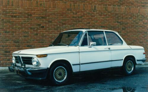 "Very cool 1973 BMW 2002 Tii posing for its ""album shot ""against the brick wall of the Mandarin restaurant."